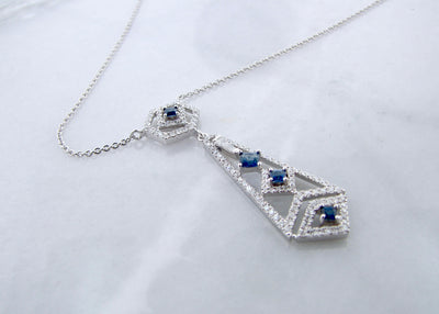 white-gold-art-deco-chandelier-princess-cut-blue-sapphire-necklace