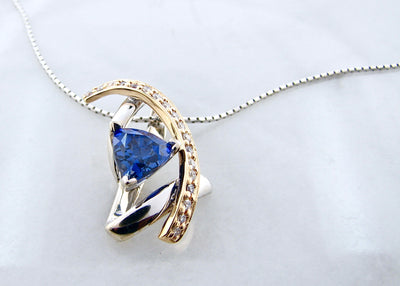 trillion-cut-tanzanite-yellow-white-gold-necklace-wexford-jewelers