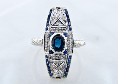 round-oval-cut-blue-sapphire-white-gold-vintage-ring-wexford-jewelers