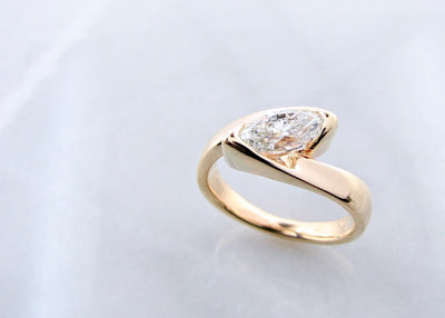 wexford-jewelers-yellow-gold-marquise-east-west-diamond-ring