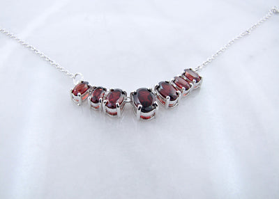 wexford-jewelers-silver-graduated-oval-garnet-necklace