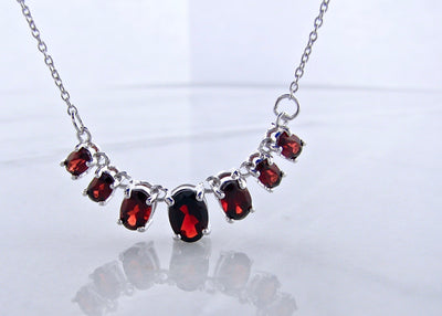 oval-garnet-sterling-silver-graduated-split-chain-necklace-wexford-jewelers