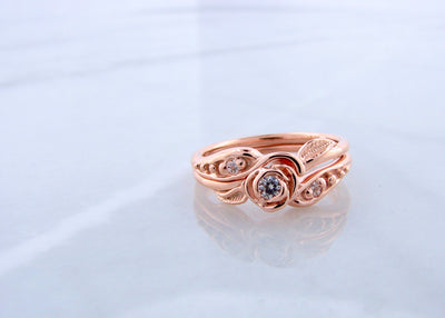 rose-gold-moissanite-tea-rose-wedding-ring-set-wexford-jewelers