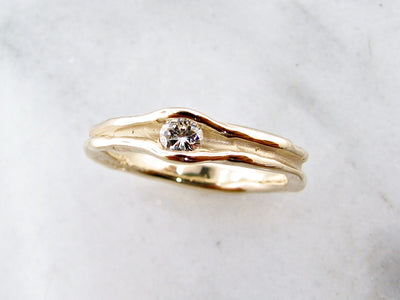 brilliant-cut-diamond-14K-yellow-gold-melted-shape-ring