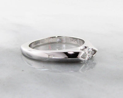 sleek-east-to-west-marquise-diamond-wedding-ring-wexford-jewelers