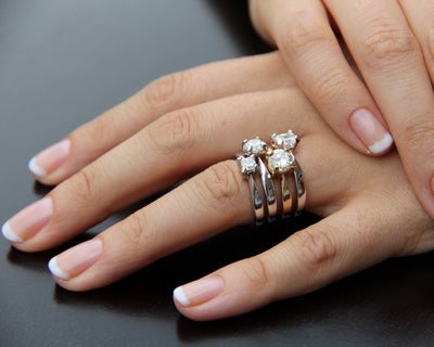 stacked-engagements-rings-prongs-diamonds-round-gold-band-wexford