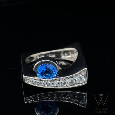 KASHMIRE blue topaz curved wall silver ring