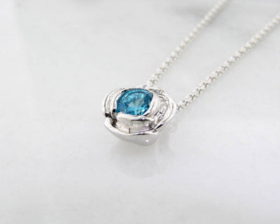 Silver Blue Topaz December Birthstone Necklace, Rose Slider