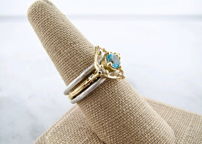 yellow-gold-silver-blue-topaz-wedding-ring-set