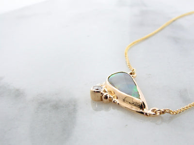 bezel-set-yellow-gold-fine-opal-necklace-wexford-jewelers