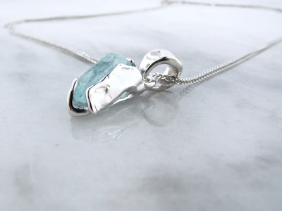 silver-bezel-set-raw-march-birthstone-necklace-wexford-jewelers