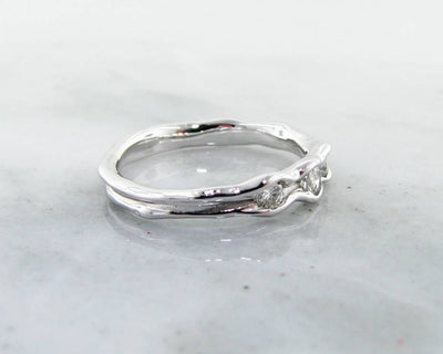 side-view-band-diamonds-bezel-ring-crafted-silky-wexford-jewelers