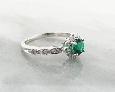 Emerald and Diamond Halo White Gold Engagement Ring