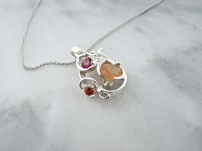 pink-toapz-fire-opal-silver-swirl-necklace-wexford-jewelers