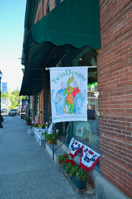 New Flag outside the TwinDesigns Gift Shop in Bristol, New Hampshire