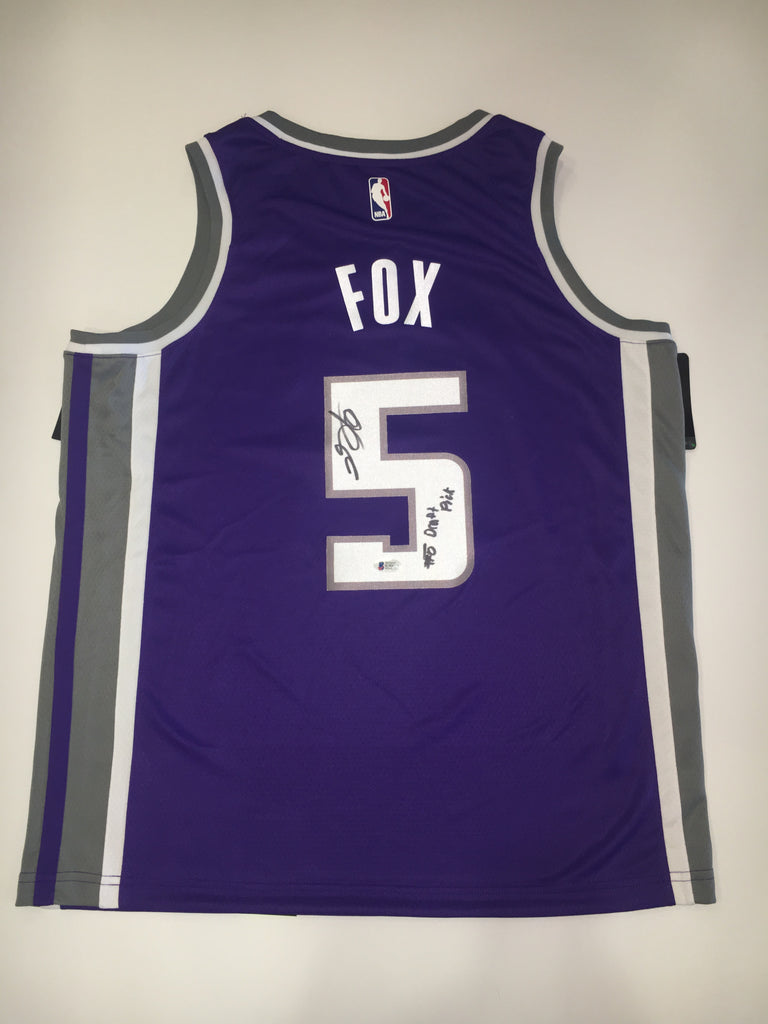 "De'Aaron Fox signed in black, on number, inscription reading ""De'Aaron Fox, #5 Draft Pick"". Inspired by Nike's Authentic jersey, Size 48, Purple."
