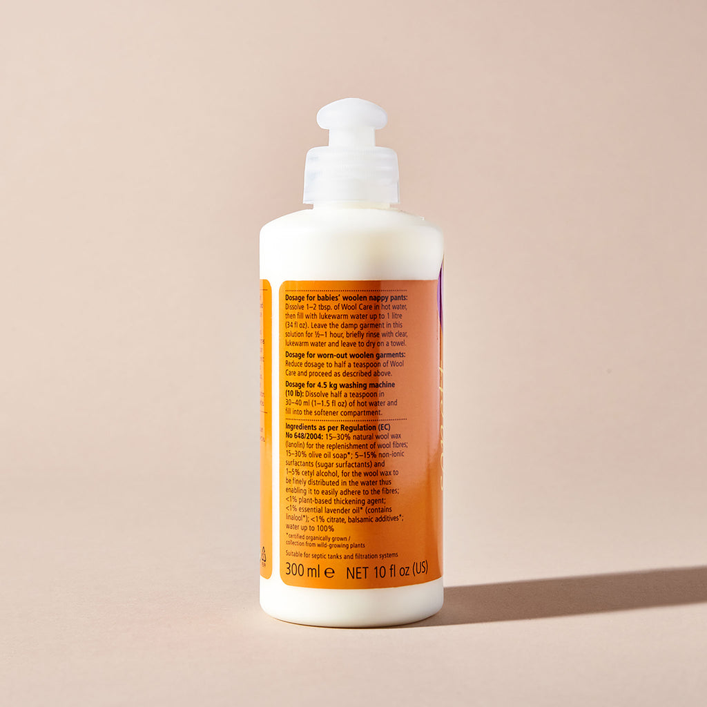 Sonett eco-friendly wool conditioner, back of orange label with instructions, shot on beige background