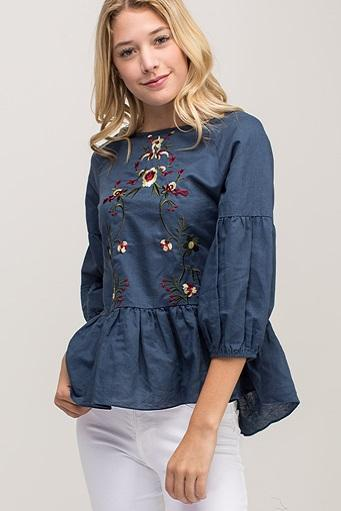 The Embroidered Linen Peplum Top in Navy