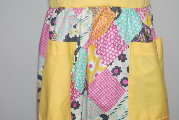 Multicolored patchwork print with pink heart