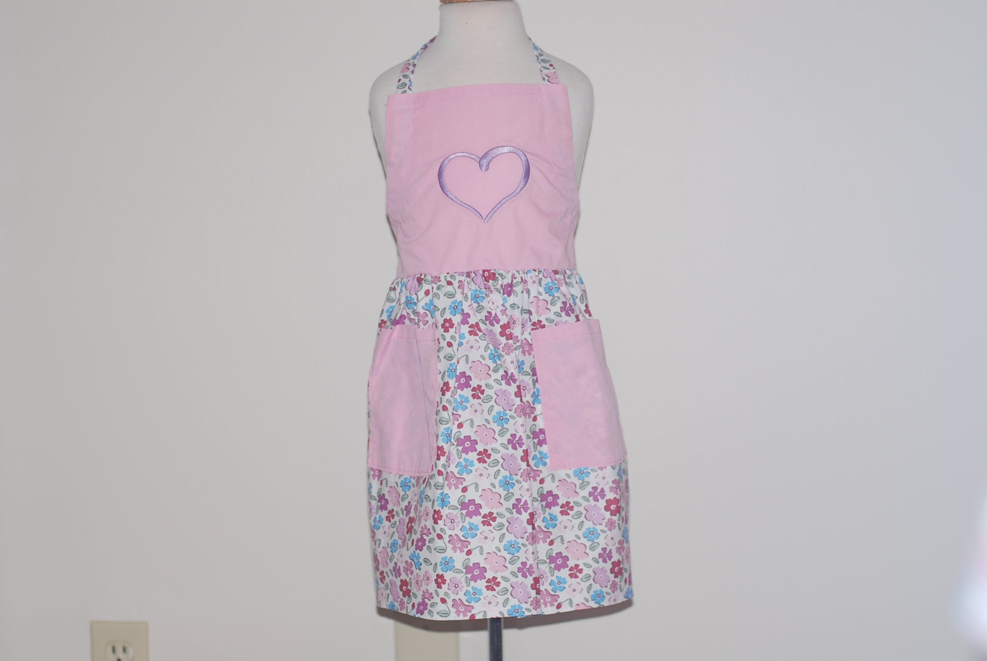 Multicolored flowers on a white skirt with a lavender heart