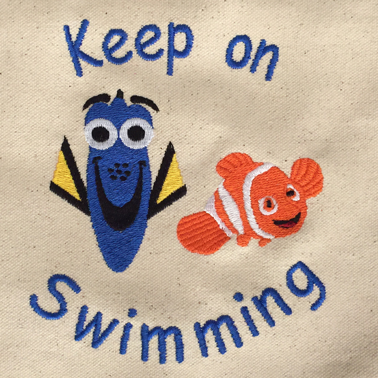 Dory and Nemo Keep on Swimming Tote bage with blue handles
