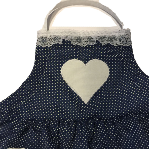 Nostalgic blue dotted Swiss with lace across bib of child's apron