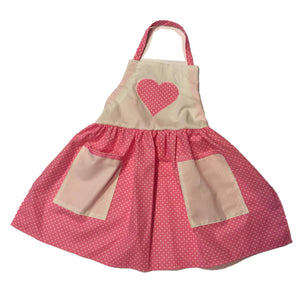 Nostalgic pink and white child's apron with big applique heart on the bib