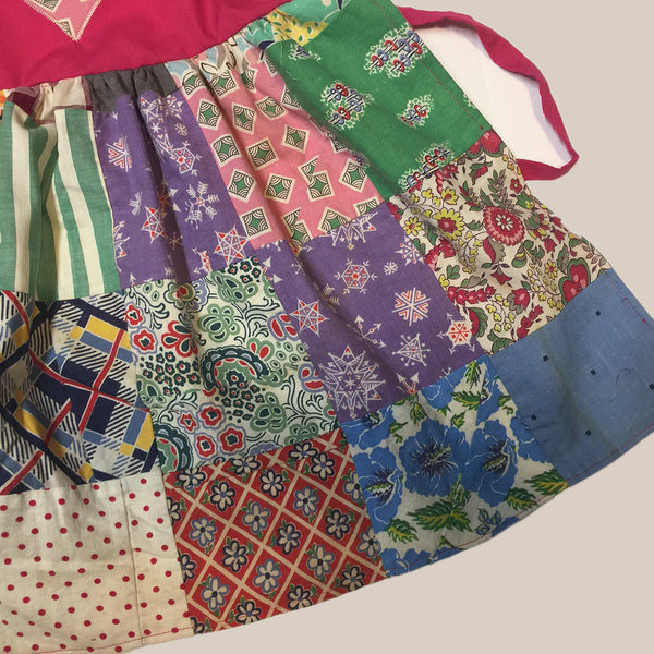 Apron fashioned from a vintage quilt with a pink bib and heart applique Child's Apron