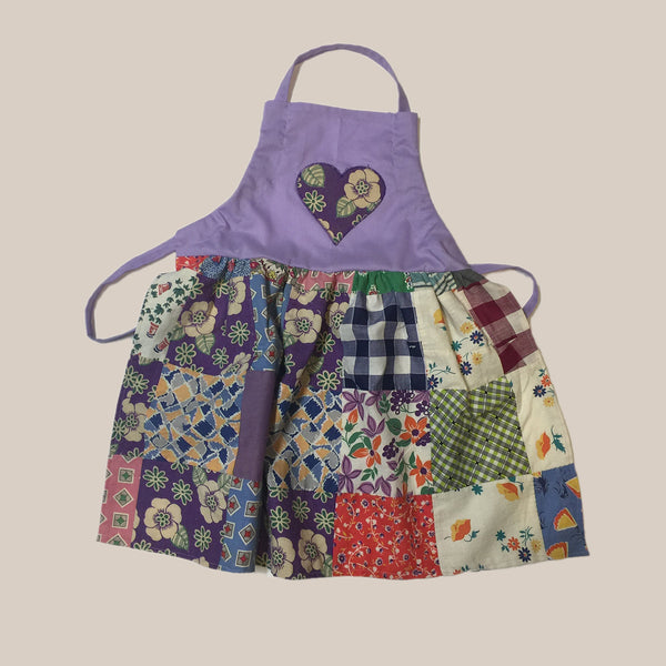 Apron fashioned from a vintage quilt with a purple bib and heart applique Child's Apron
