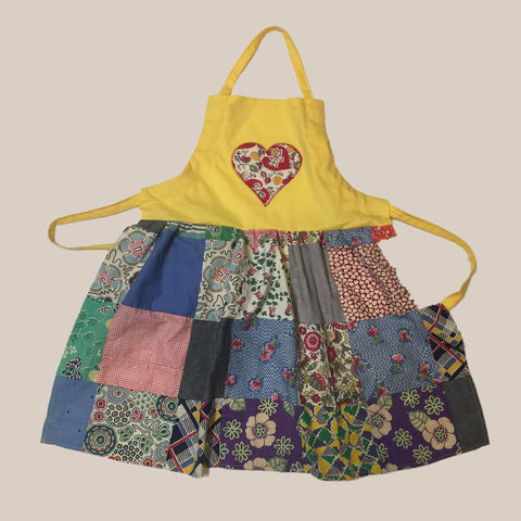 Apron fashioned from a vintage quilt with a yellow bib and heart applique Child's Apron