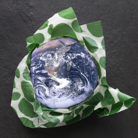 A composite image of Earth, wrapped in a Leafy Green print Z Wrap
