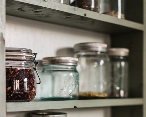 pantry shelves with mason jars storing different ingredients