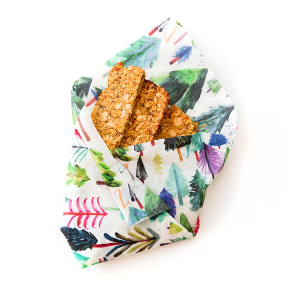 snack bars bundled in a white and rainbow tree print Z Wrap; the name of the design is Wild Wanderers