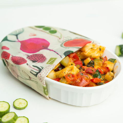 a yummy casserole with tortellinis and veggies in a white corningware dish, covered with the farmhouse pattern Z Wrap