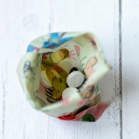 a Bees Love These print Z Wrap contains a handful of vitamins and antacid tablets