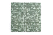 Beeswax food wrap in green with names of cheeses, like havarti and gouda, written in white