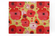 yellow reusable food wrap with bright red and pink flowers design