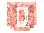 beeswax food wrap in three sizes, in red with a white dot pattern