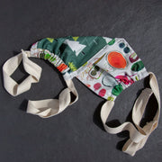 Cloth face mask with a green tree pattern on one side and colorful fruits and vegetables on the other