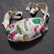 Cloth face mask with a colorful vegetable print