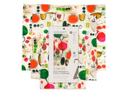 white beeswax reusable food wrap with colorful fruits and vegetables design