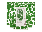 three organic reusable food wraps in a white and leafy green design
