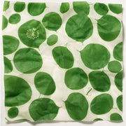 bees wax wrap in white with bright green leaves motif