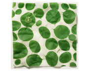 reusable food wrap in white with bright green leaves print