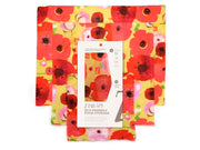 three reusable food wraps in colorful red and pink poppy motif