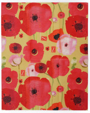 beeswax food wrap in a bright pink and red poppies design