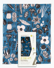 beeswax reusable food wrap in blue with black and white fruits and leaves design