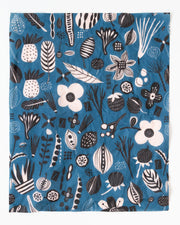 blue beeswax food wrap with white and black flowers and fruits design