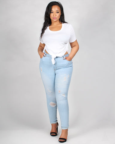 Light-wash distressed skinny jeans with tie-front white t-shirt