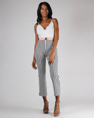 High-waisted, striped ankle pants with white camisole